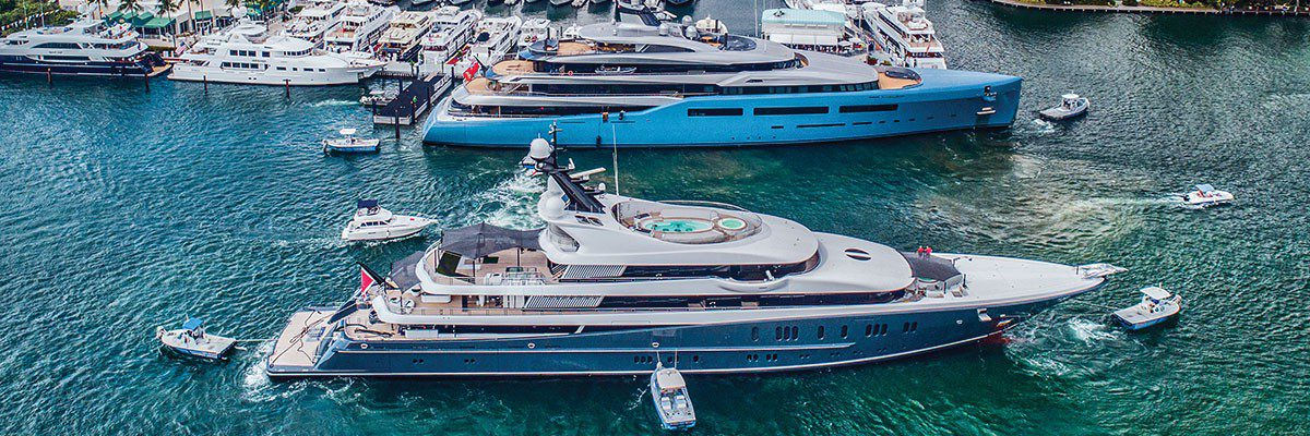 two boats at superyacht village